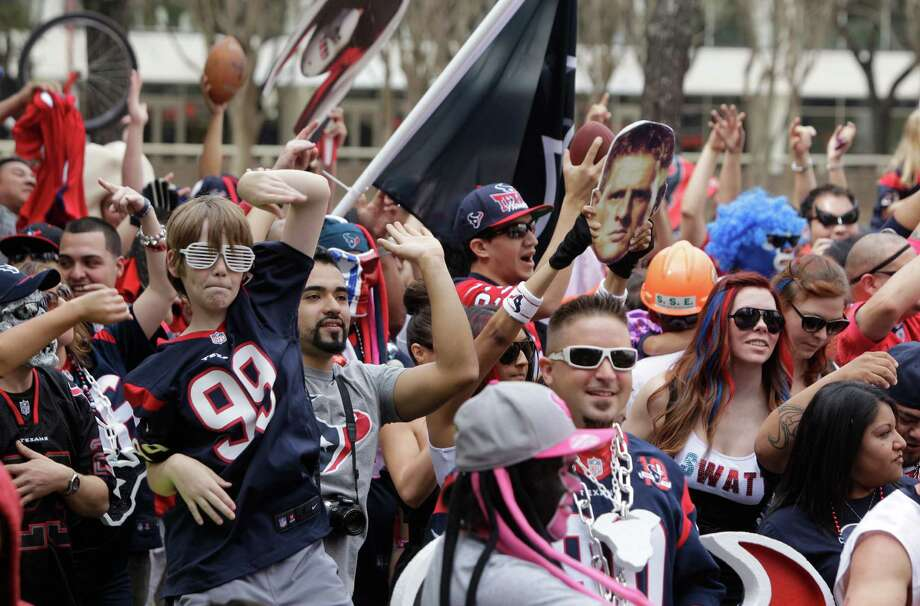"Everyone was doing this dance this year. And we do mean everyone, including Texans fans at Tranquility Park in February. Memes and videos of the ""Shake,"" including one featuring the Miami Heat, went viral.  Photo: Melissa Phillip, Houston Chronicle / © 2013  Houston Chronicle"
