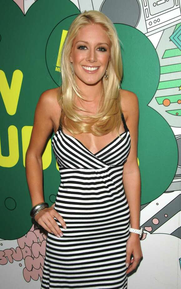 """BEFORE:TV personality Heidi Montag makes an appearance for MTV's """"Total Request Live"""" in 2008, before she started having cosmetic procedures to change her face and body.      BEFORE: TV personality Heidi Montag makes an appearance for MTV's """"Total Request Live"""" in 2008, before she started having cosmetic procedures to change her face and body. Photo: Peter Kramer, STR / KRAPE"""