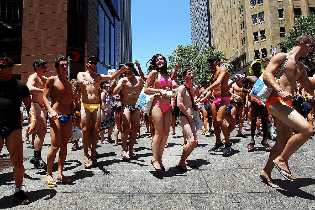 While Americans are freezing their butts off amid a rash of winter storms, Australians are flaunting their tanned bikini bods thanks to the axial tilt of the Earth. Jealous much?Above: Sydneysiders take part in the 'AIME Strut the Streets' parade in Martin Place on December 13, 2013 in Sydney.