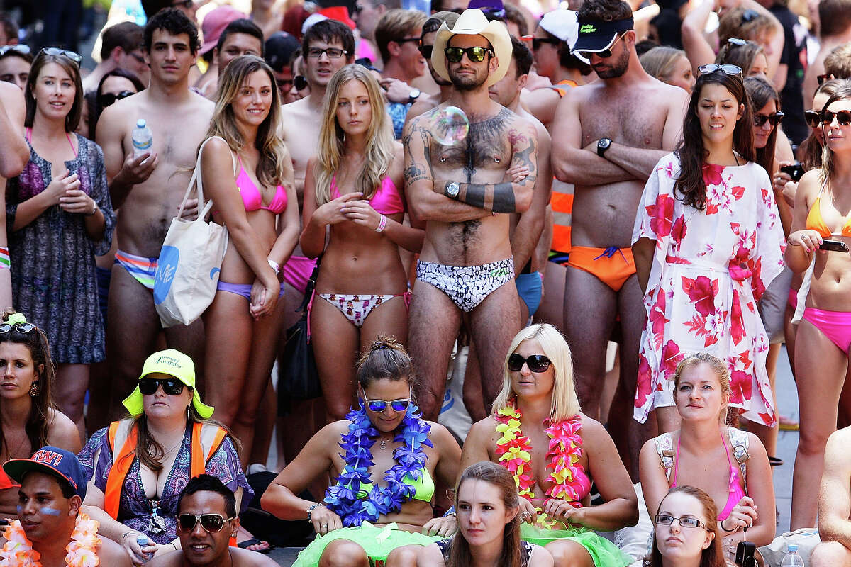 Sydneysiders take part in the 'AIME Strut the Streets' parade in Martin Place on December 13, 2013 in Sydney, Australia.