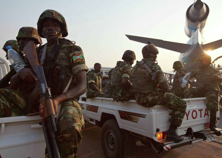Congolese peacekeepers  monitor a United Nations  cargo plane carrying food and medical supplies.  Sectarian violence in the past week has killed more than 500 people in the Central African Republic. Photo: Ivan Lieman / Getty Images / AFP