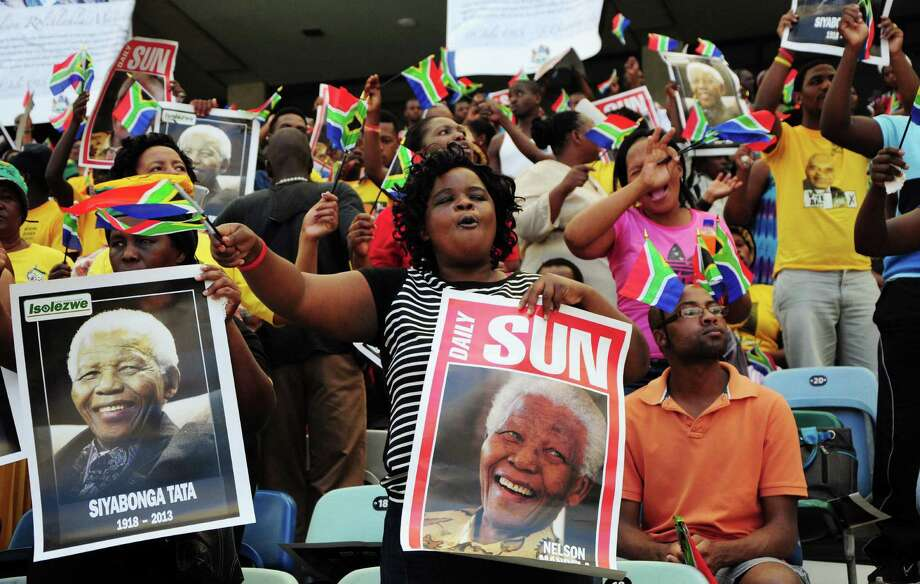 South Africans attend a memorial ceremony for former President Nelson Mandela at the Moses-Mabhida Stadium in Durban, southeast of Johannesburg and Pretoria, where Mandela lay in state. Photo: Anesh Debiky / Getty Images / AFP PHOTO