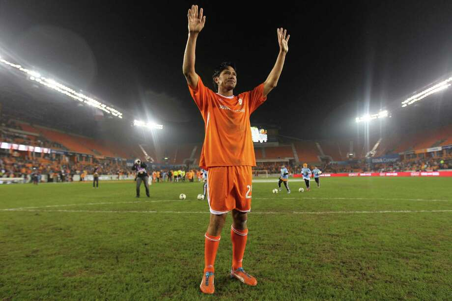 Houston Dynamo's Brian Ching acknowledges the crowd after the Brian Ching Testimonial Match, Friday, December 13, 2013, at BBVA Compass Stadium in Houston. Photo: Eric Christian Smith, For The Chronicle