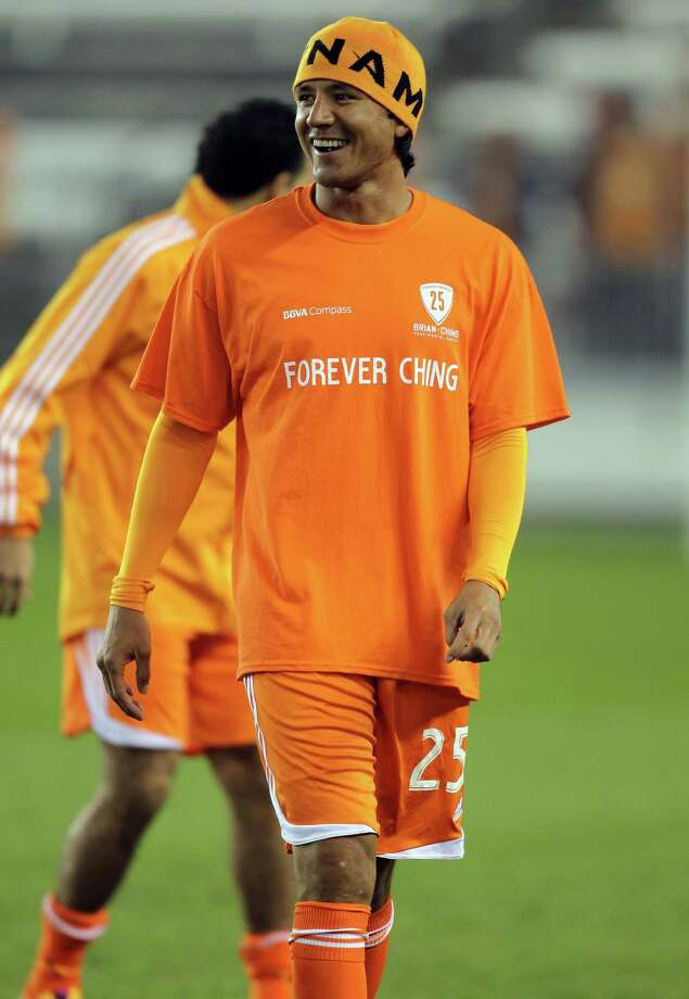 Brian Ching smiles during warmups before the  Brian Ching Testimonial match, Friday, December 13, 2013, at BBVA Compass Stadium in Houston. Photo: Eric Christian Smith, For The Chronicle