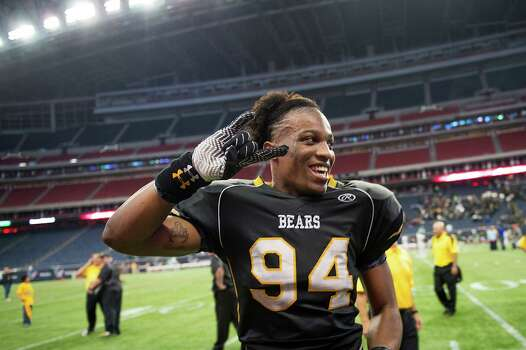 Brennan defensive end Derick Roberson (94) flashes a Hook 'em Horns hand signal after a victory over Stratford in a class 4A state semifinal high school football playoff game at Reliant Stadium on Friday, Dec. 13, 2013, in Houston.  Roberson, a senior, has committed to the University of Texas. Photo: Smiley N. Pool, Houston Chronicle / © 2013  Houston Chronicle