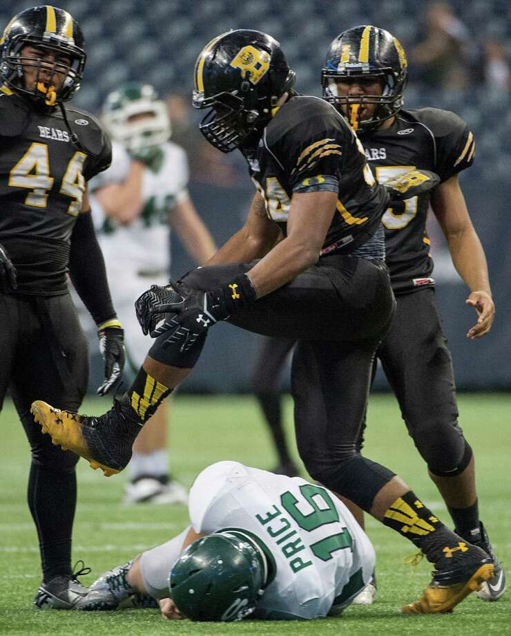 Brennan defensive end Derick Roberson (94) celebrates after sacking Stratford quarterback  Freddy Price (16) during the second half of a class 4A state semifinal high school football playoff game at Reliant Stadium on Friday, Dec. 13, 2013, in Houston. Photo: Smiley N. Pool, Houston Chronicle / © 2013  Houston Chronicle