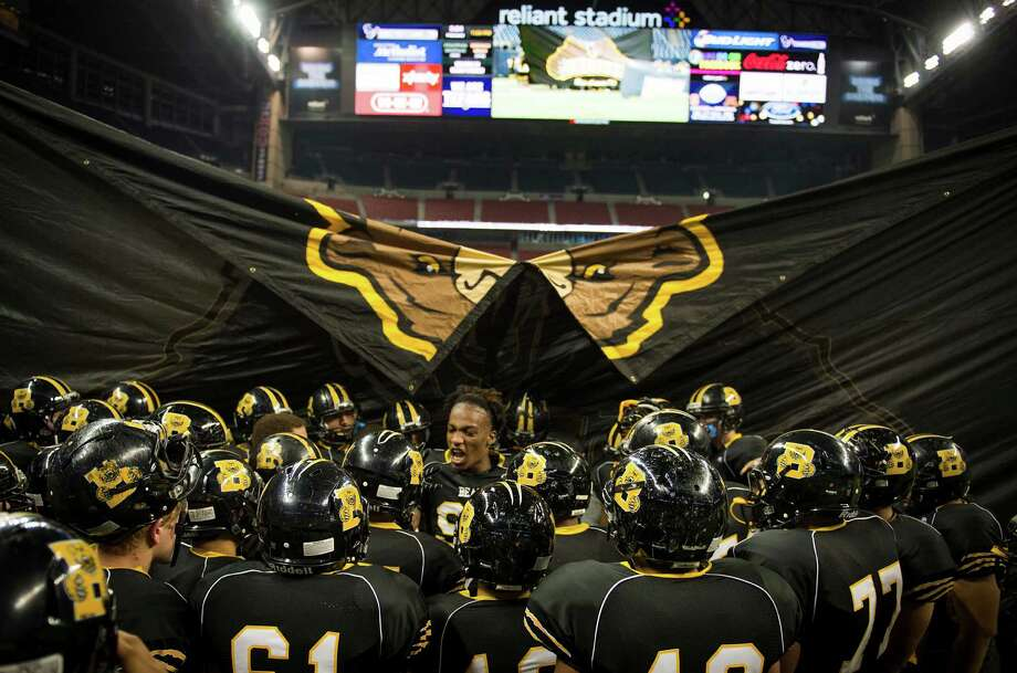 Brennan players huddle around defensive end Derick Roberson before facing Stratford in a class 4A state semifinal high school football playoff game at Reliant Stadium Friday, Dec. 13, 2013, in Houston.  Smiley N. Pool / Houston Chronicle ) Photo: Smiley N. Pool, Houston Chronicle / © 2013  Houston Chronicle