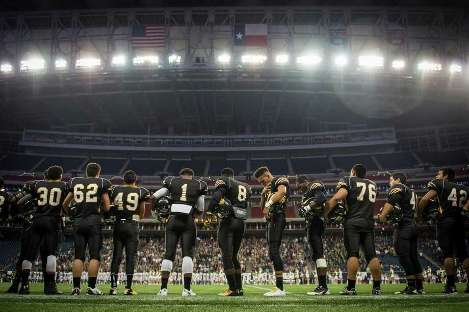 Brennan players stand for the national anthem before facing Stratford in a class 4A state semifinal high school football playoff game at Reliant Stadium Friday, Dec. 13, 2013, in Houston.  Smiley N. Pool / Houston Chronicle ) Photo: Smiley N. Pool, Houston Chronicle / © 2013  Houston Chronicle