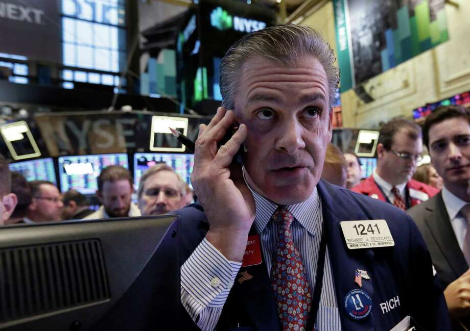 In this file photo, trader Richard DeViccaro works on the floor of the New York Stock Exchange. (AP Photo/Richard Drew) Photo: Richard Drew, STF / AP