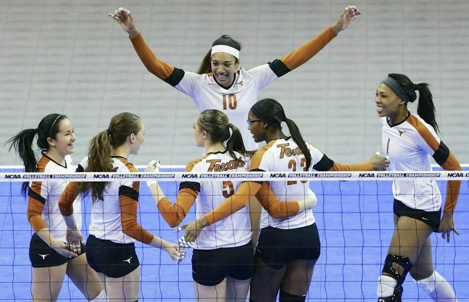Haley Eckerman (10) and her Texas teammates celebrate a point during their four-set victory over American. The top-seeded Longhorns will face Nebraska. Photo: Nati Harnik / Associated Press / AP