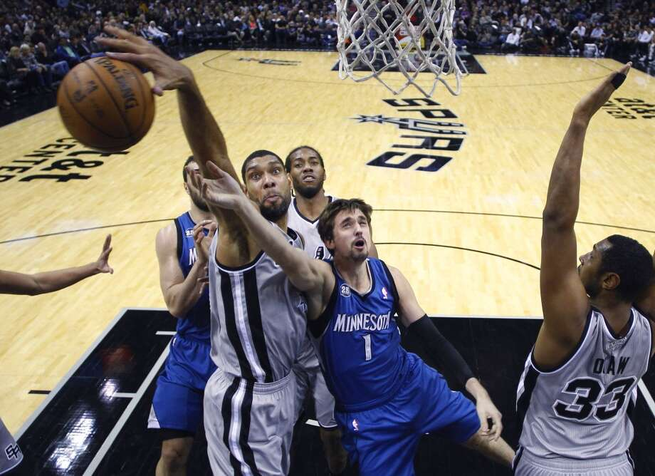 San Antonio Spurs' Tim Duncan, left, blocks Minnesota Timberwolves' Alexey Shved (1) as he tries to score during the first half on an NBA basketball game, Friday, Dec. 13, 2013, in San Antonio.  (AP Photo/Eric Gay) Photo: Associated Press