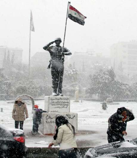 Syrians play in the snow in Damascus as a blustery storm, dubbed Alexa, brought gusty winds, torrential rains and heavy snowfall to most parts of the nation and much of the Mideast. Photo: Uncredited, Associated Press / AP