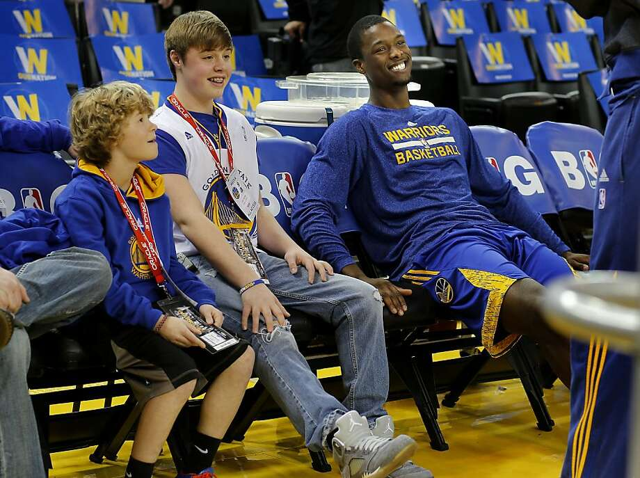 Cole Vitiritto (center) sat courtside with brother Luke and forward Harrison Barnes before Wednesday's Warriors game. Photo: Brant Ward, The Chronicle