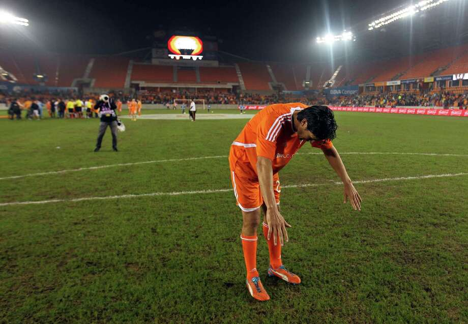 Former Dynamo forward Brian Ching bows to the crowd after the historic testimonial matchFriday night. Ching becomes the first American player in Major League Soccer to receive the honor. He helped lead the team to back-to-back MLS Cup wins in 2006 and 2007. Photo: Eric Christian Smith, Freelance