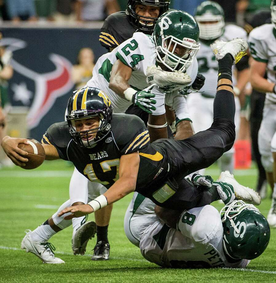 Brennan quarterback Da'shawn Key (17) dives for a first down as he is brought down by Stratford's Terrance Peters,Jr. during the first half of a class 4A state semifinal high school football playoff game at Reliant Stadium on Friday, Dec. 13, 2013, in Houston. Photo: Smiley N. Pool, Houston Chronicle / © 2013  Houston Chronicle