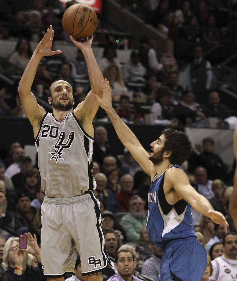 Manu Ginobili (left) drains a 3-pointer over Ricky Rubio to tie the game at 102 late in the fourth. Ginobili finished with 20 points. Photo: Kin Man Hui / San Antonio Express-News / ©2013 San Antonio Express-News
