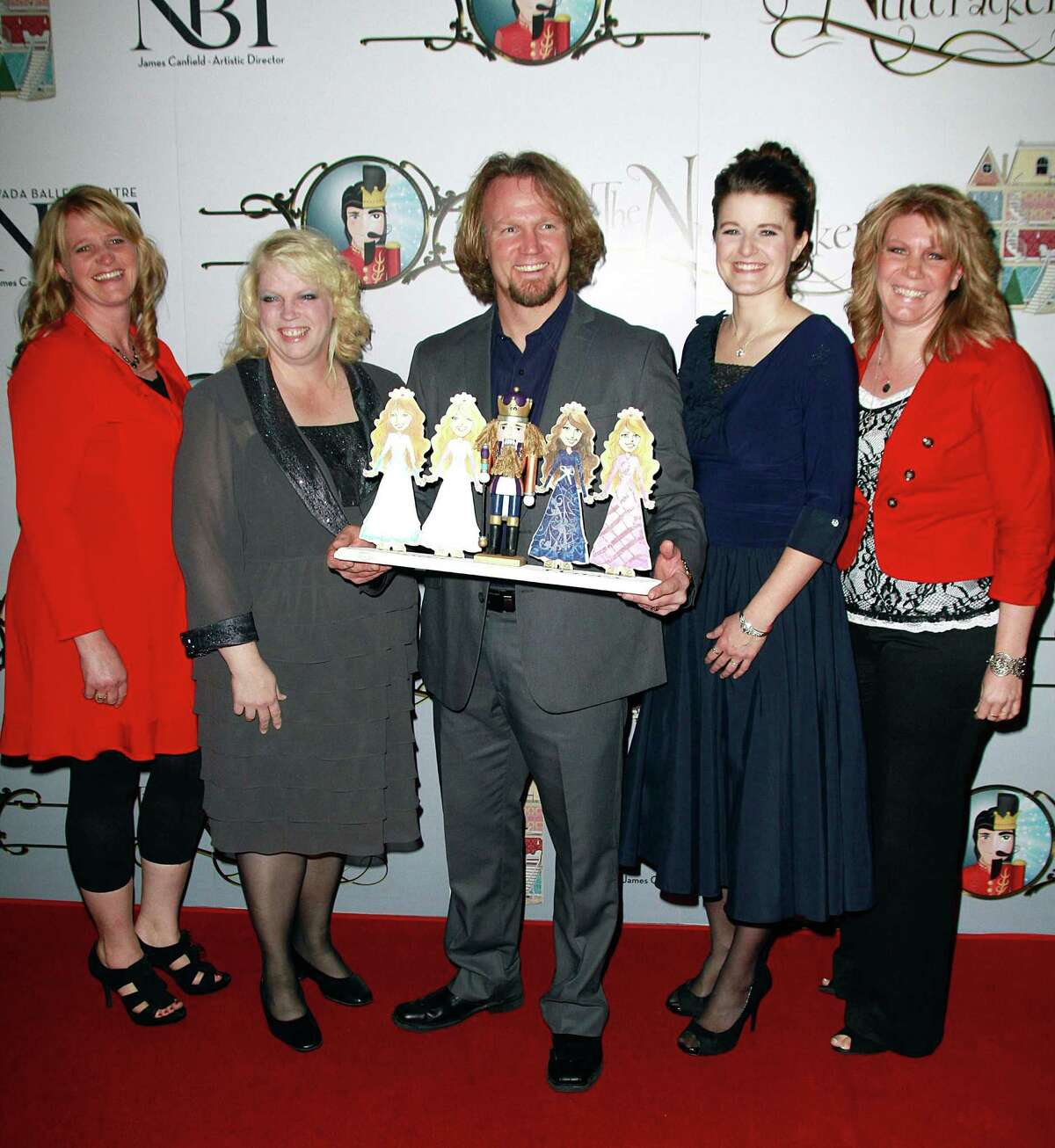 Polygamist Kody Brown, center, poses with his four wives (from left) Christine Brown, Janelle Brown, Robyn Brown and Meri Brown at the Nevada Ballet Theatre's production of