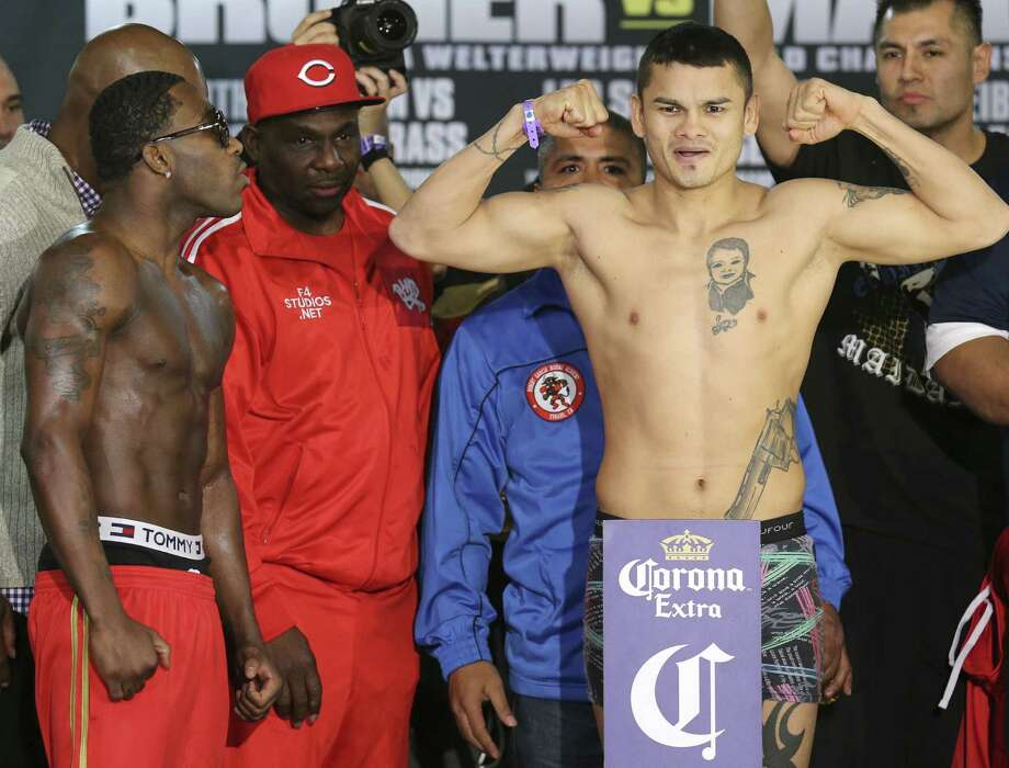 WBA welterweight champ Adrien Broner (left) weighed in at 144.4 pounds Friday. Marcos Maidana, his opponent, weighed 146.2. Photo: Edward A. Ornelas / San Antonio Express-News / © 2013 San Antonio Express-News