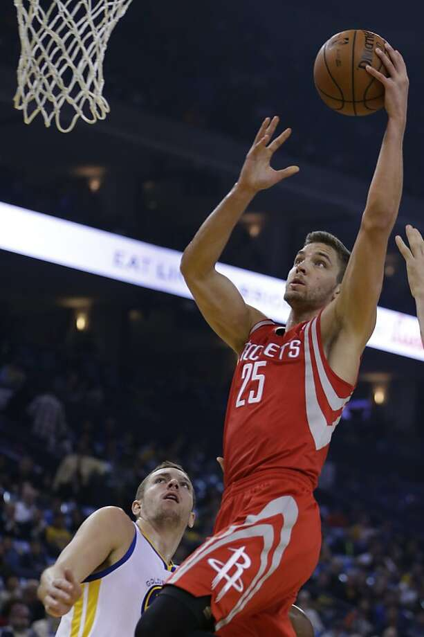 Chandler Parsons shoots over David Lee in the first half, when Houston built as much as a 13-point lead. Photo: Ben Margot, Associated Press