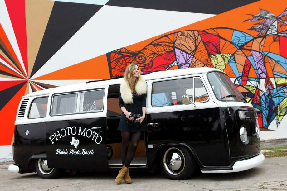 Brittany Havican, a nurse who also works as a wedding photographer, uses a vintage Volkswagen van that doubles as a photo booth. Photo: Brett Coomer, Staff / © 2013 Houston Chronicle