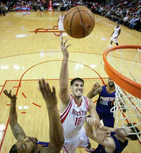 Omri Casspi, center, has gained confidence after landing in a situation with the Rockets that is more conducive to maximizing his talents. Photo: Brett Coomer, Staff / © 2013 Houston Chronicle