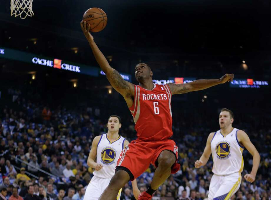 Terrence Jones leaves Golden State defenders in his wake en route to an easy basket for the Rockets. Photo: Ben Margot, STF / AP