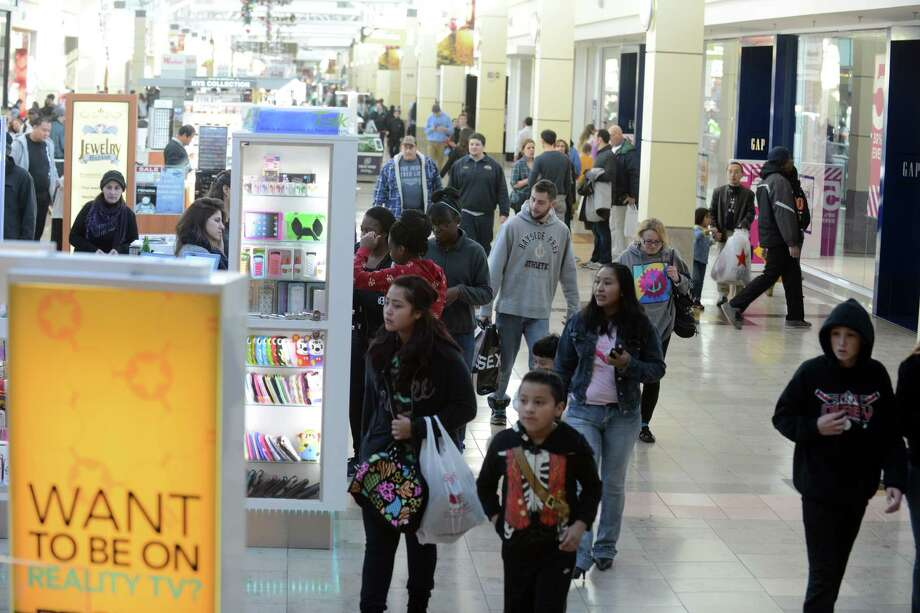 "Shoppers at Westfield Connecticut Post mall in Milford. the combination of the seasonal shopping surge and the increasingly common occurrence of gunmen opening fire in public places puts a priority on security in places like shopping centers, one type of institution that law enforcement considers a ""soft"" or vulnerable target for mass shootings or terrorist attacks. Photo: Autumn Driscoll / Connecticut Post"