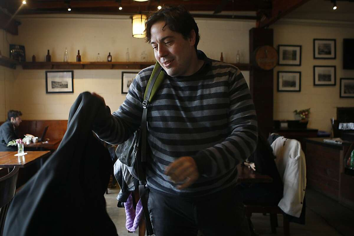 Antonio Garcia, 37 years old, vice president of Nanigans heads to an appointment as he gets ready to leave the Creamery in San Francisco, Calif., on Tuesday, December 3, 2013.