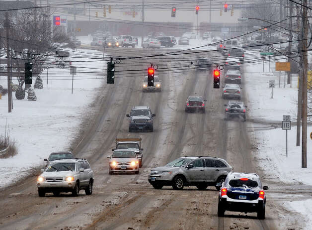 Traffic slowly moves along the Barnum Avenue Cutoff during the snow storm in Stratford, Conn. on Saturday December 14, 2013. Photo: Christian Abraham / Connecticut Post