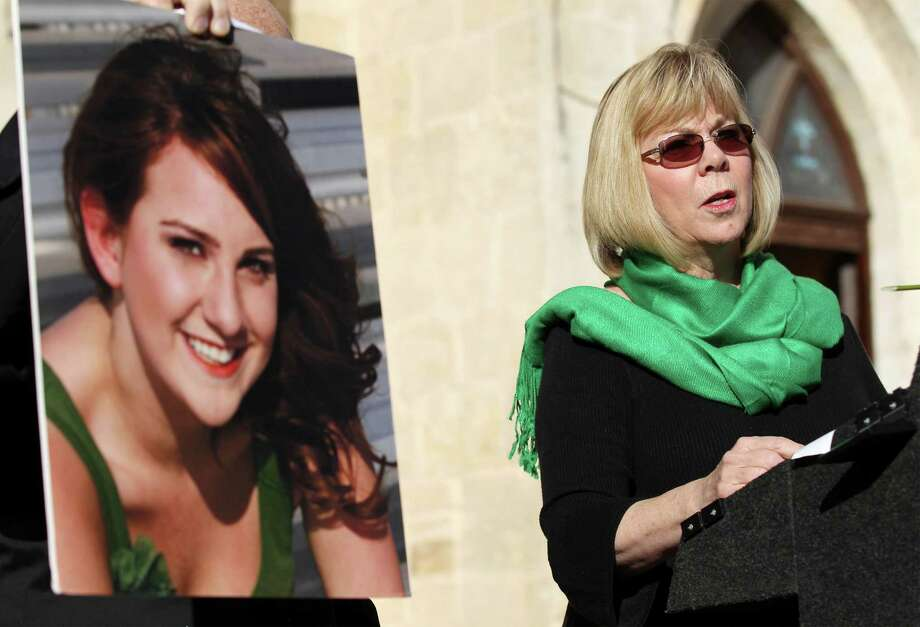 Sandy Phillips, mother of Aurora, Colorado shooting victim Jessica Ghawi (shown in a photo on left), addresses about 50 people along with the group Moms Demand Action at Main Plaza to remember victims from last year's shooting at Sandy Hook Elementary in Newton, Connecticut. Photo: Kin Man Hui, San Antonio Express-News / ©2013 San Antonio Express-News