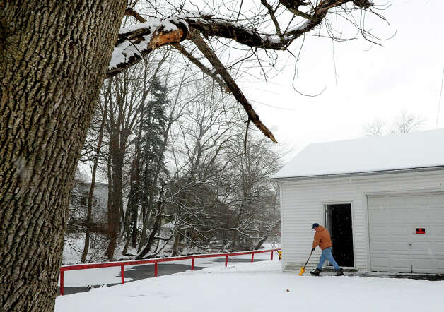 Dave Quinn shovels snow in the back of his apartment building during the snow storm in Milford, Conn. on Saturday December 14, 2013. Photo: