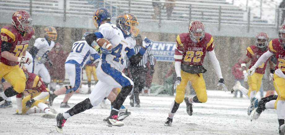 Class M football championship action between Brookfield and St Joseph high schools at Central Connecticut State University's Arute Field in New Britain, Conn, on Saturday, December 14, 2013. St Joseph's beat Brookfield, 54-14. Photo: H John Voorhees III / The News-Times Freelance