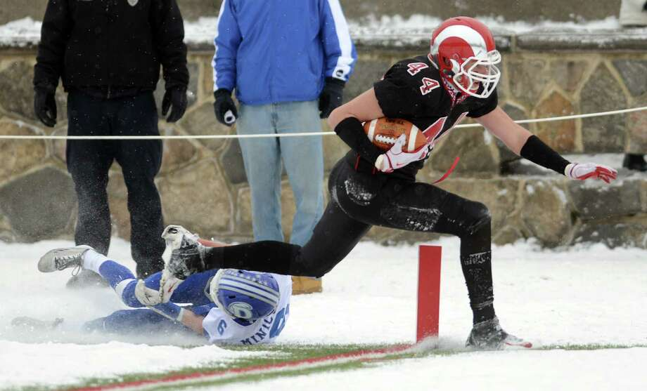 New Canaan's Zachary Allen scores a touchdown as Darien's Colin Minicus defends during the Class L state championship game Saturday, Dec. 14, 2013 at Boyle Stadium in Stamford, Conn. Photo: Autumn Driscoll / Connecticut Post