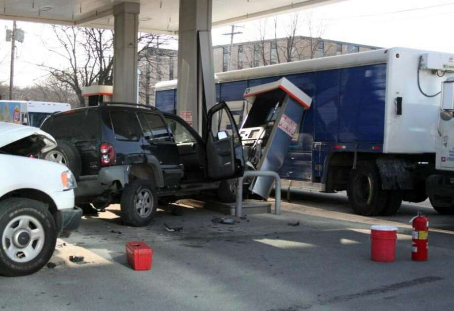 An accidentjust before 3:00pm Monday, the result of police activity, when an SUV struck a gas pump at Cumberland Farms on Kings Highway East, where a black Jeep pushed the pump off its pedestal into a Pepsi delivery truck on the other side of the island. Photo: Contributed Photo / Connecticut Post Contributed