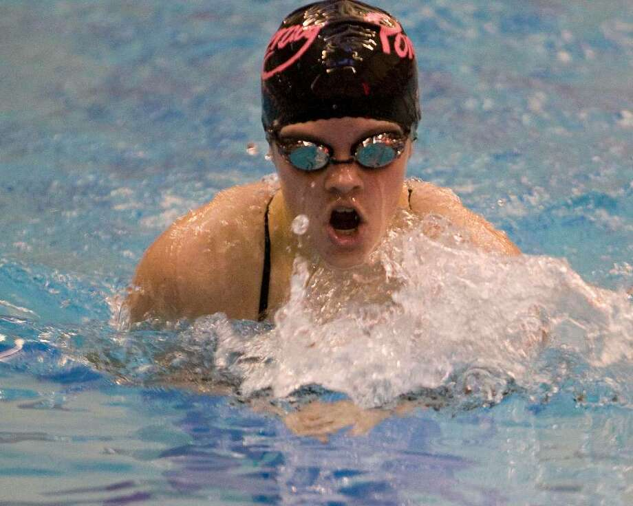 Pomperaug's Elizabeth McDonald finishes first in the 200 yard IM at the SWC Girls Swimming Championships Saturday at Masuk High. Photo: Barry Horn / The News-Times Freelance