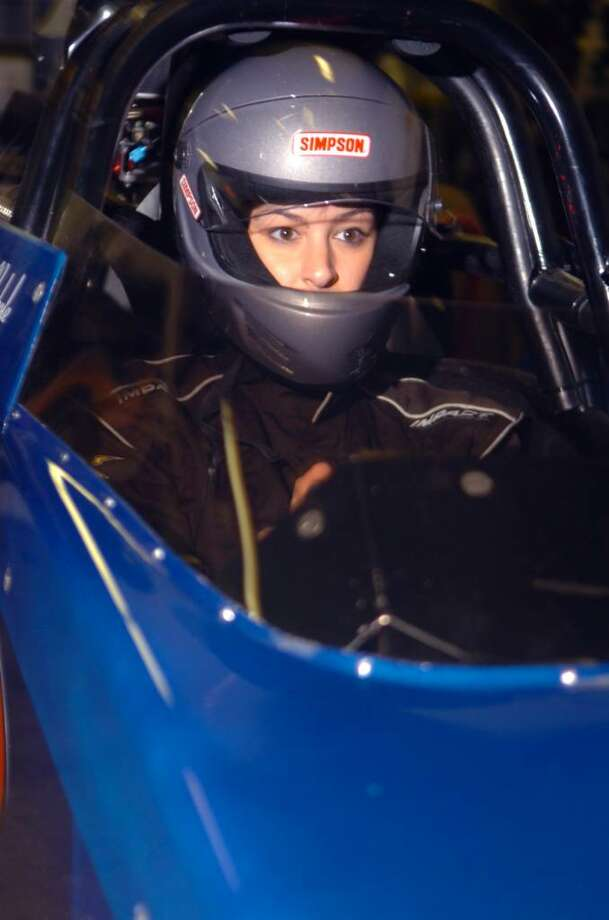 Kaitlyn Sobeski, a 24-year-old Greenwich High School graduate and former cheerleader, who is now learning to race a rear-engine dragster in Florida.  She sits in the dragster, on January 24, 2010, in her father, Scotty Sobeski's, garage. Her first race will be in March. Photo: Helen Neafsey / Greenwich Time