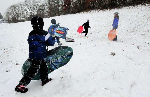 Families take advantage of the snow storm to get in some sledding time in Stratford, Conn. on Saturday December 14, 2013. Photo: Christian Abraham / Connecticut Post