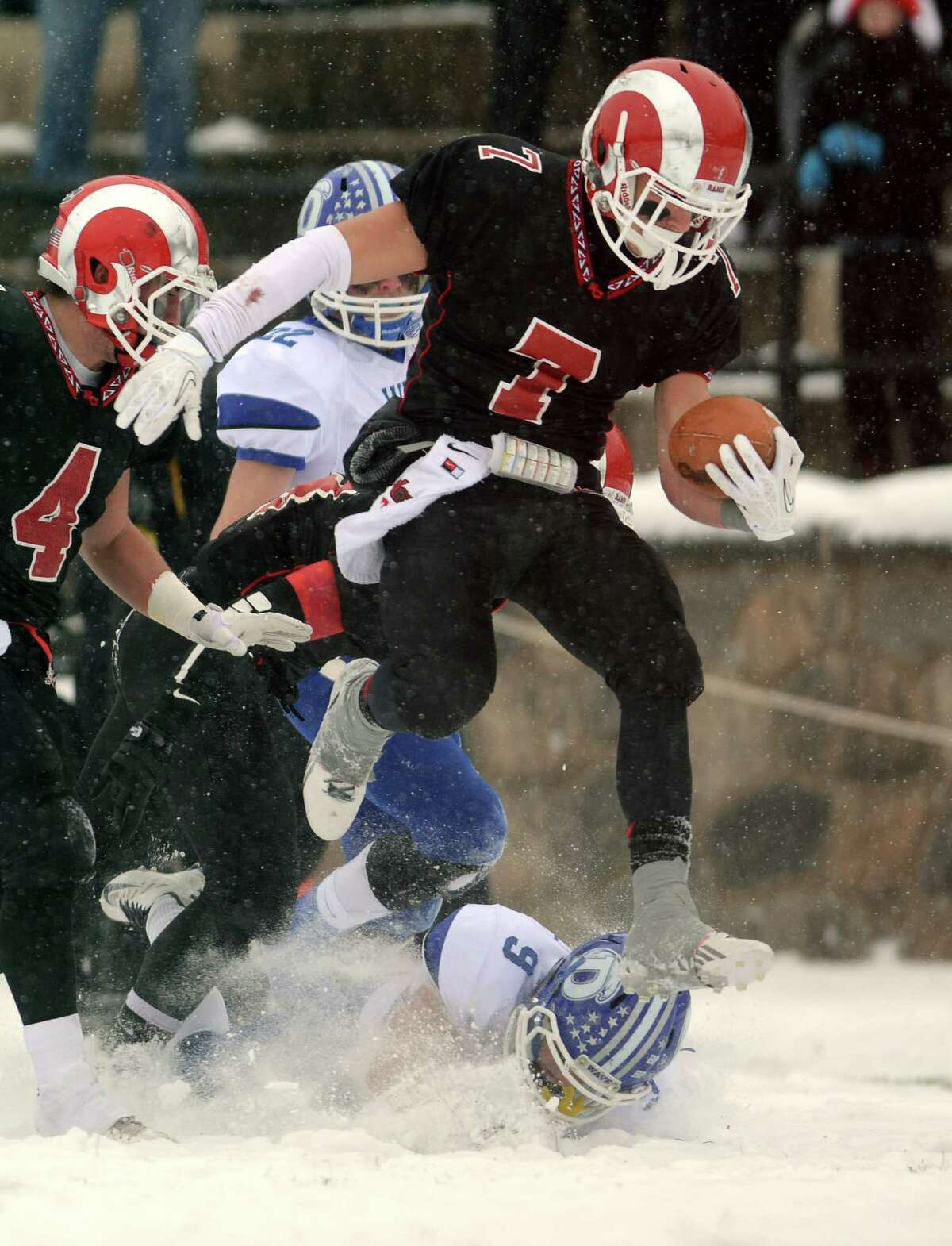 New Canaan's Alexander LaPolice escapes a tackle on his way to a touchdown during the Class L state championship game against Darien on Saturday, Dec. 14, 2013 at Boyle Stadium in Stamford, Conn.
