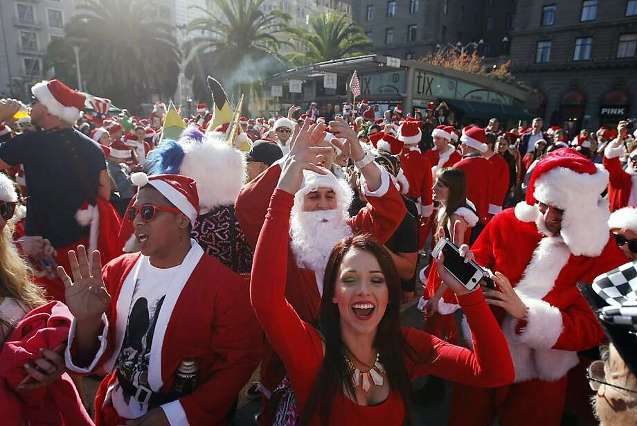 Bad Santas and their admirers pack Union Square for SantaCon, a celebration of debauchery. Photo: Michael Short, The Chronicle