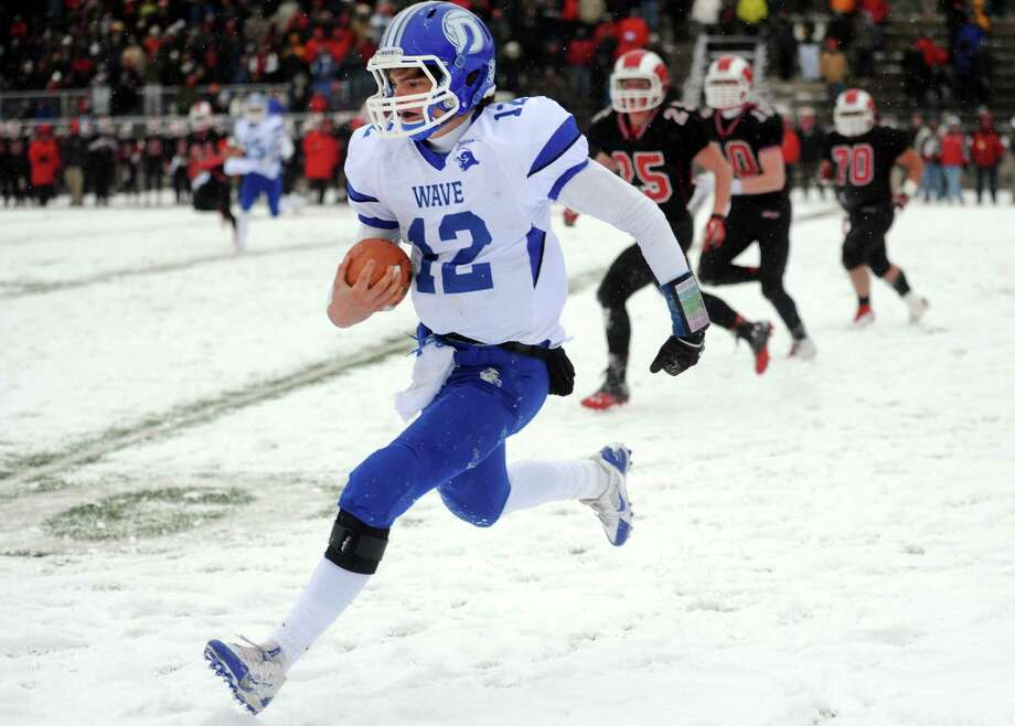 Darien's Silas Wyper carries the ball during the Class L state championship game against New Canaan on Saturday, Dec. 14, 2013 at Boyle Stadium in Stamford, Conn. Photo: Autumn Driscoll / Connecticut Post