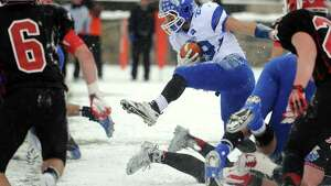 Darien's Myles Ridder carries the ball during the Class L state championship game against New Canaan on Saturday, Dec. 14, 2013 at Boyle Stadium in Stamford, Conn.