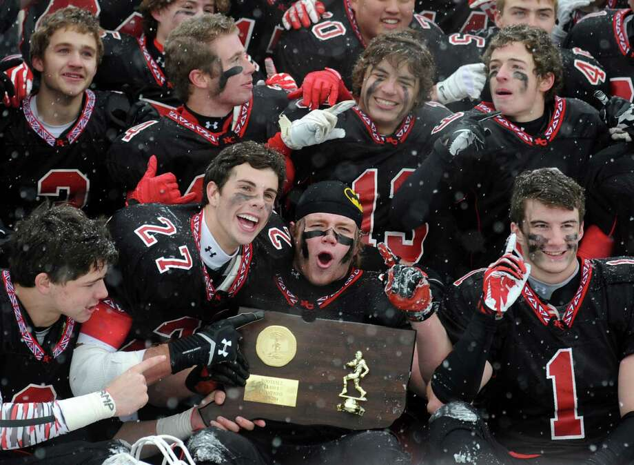 New Canaan celebrates their 44-12 win over Darien in the Class L state championship on Saturday, Dec. 14, 2013 at Boyle Stadium in Stamford, Conn. Photo: Autumn Driscoll / Connecticut Post