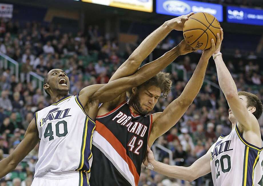 Robin Lopez (center) has become an integral part of the Portland Trail Blazers' early-season success. For the first time in their six-year NBA careers, both Lopez twins are thriving. Photo: Rick Bowmer, Associated Press