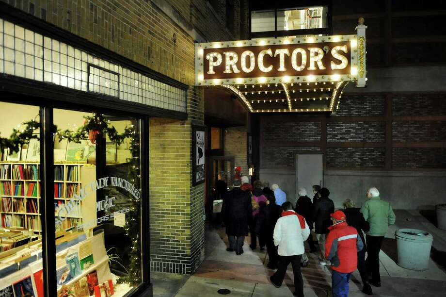 Patrons enter Proctors Theatre  on Thursday, Dec. 12, 2013, in Schenectady, N.Y. (Cindy Schultz / Times Union) Photo: Cindy Schultz / 00025010A