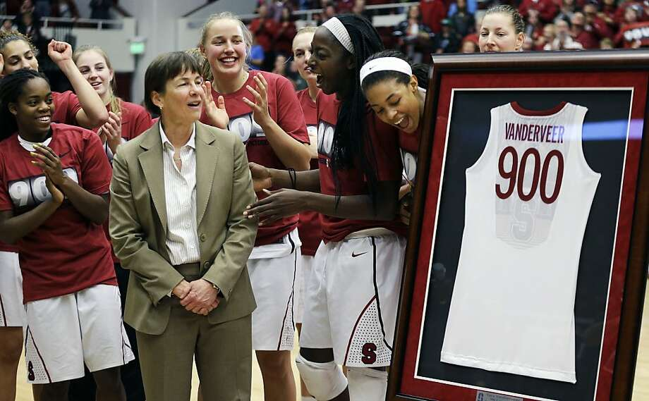 Stanford's Tara VanDerveer is presented with a framed jersey to commemorate her 900th career coaching victory. Photo: Ben Margot, Associated Press