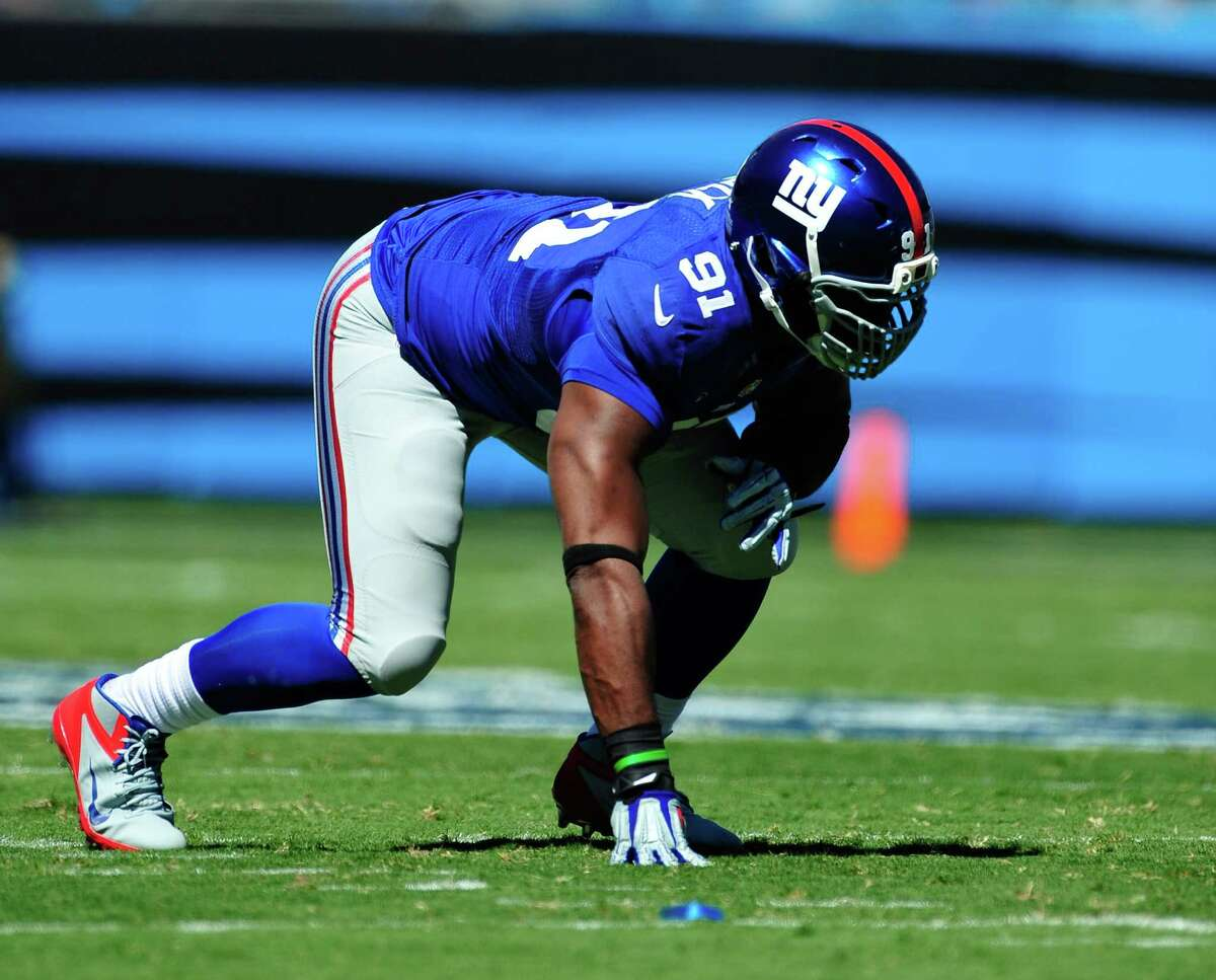 CHARLOTTE, NC - SEPTEMBER 22: Justin Tuck #91 of the New York Giants against the Carolina Panthers during play at Bank of America Stadium on September 22, 2013 in Charlotte, North Carolina. The Panthers won 38-0. (Photo by Grant Halverson/Getty Images)