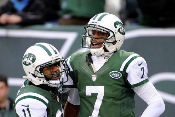 New York Jets quarterback Geno Smith (7) is congratulated by wide receiver Jeremy Kerley (11) after Smith scored on a touchdown run against the Oakland Raiders during the second half of an NFL football game, Sunday, Dec. 8, 2013, in East Rutherford, N.J. (AP Photo/Bill Kostroun) ORG XMIT: ERU117