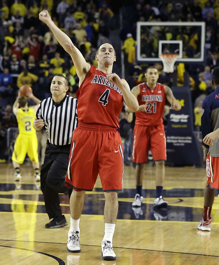 Arizona guard T.J. McConnell celebrates as the clock ticks down in Ann Arbor, Mich. Photo: Carlos Osorio, Associated Press