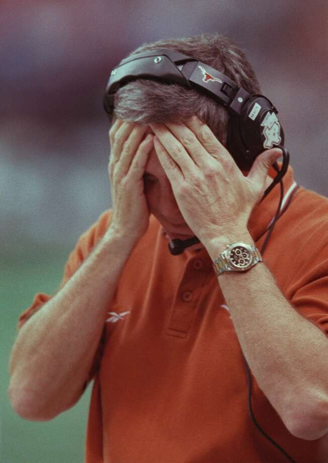 1999 season  Mack Brown couldn't bear to watch as Nebraska defeated the Longhorns in the Big 12 Championship Game at the Alamodome in San Antonio. Texas finished the season with a 9-3 record after losing to Arkansas in the Cotton Bowl. Photo: Smiley N. Pool, Houston Chronicle