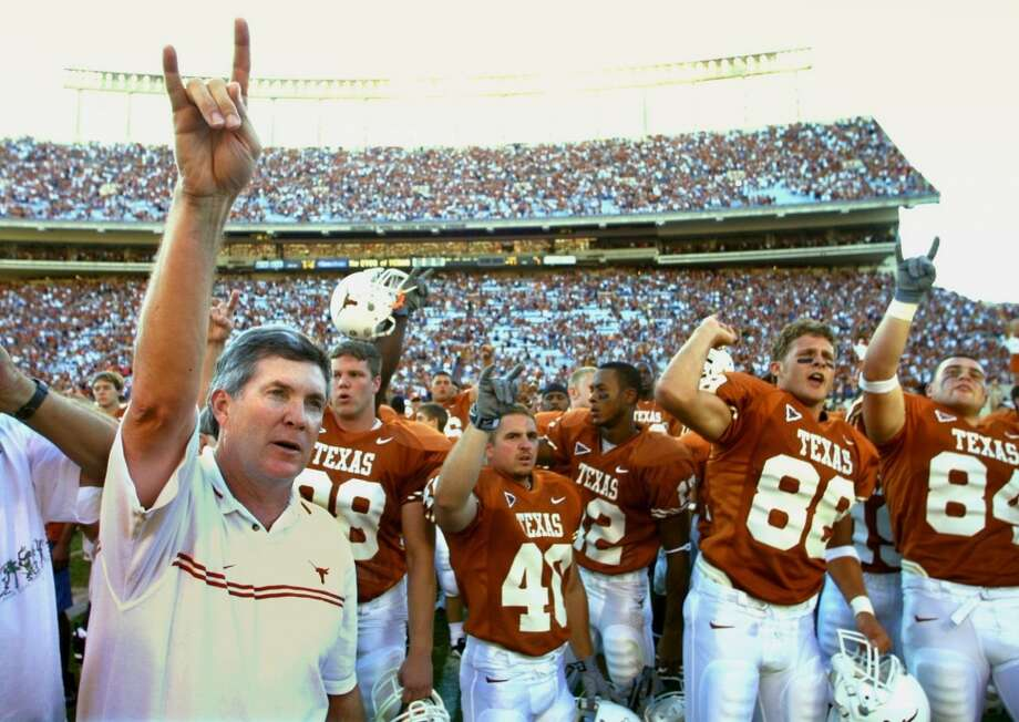 2001 season  Mack Brown and the Longhorns began their impressive run of nine consecutive double-digit win seasons as they went 11-2 and defeated Washington in the Holiday Bowl. Photo: Erich Schlegel, Dallas Morning News